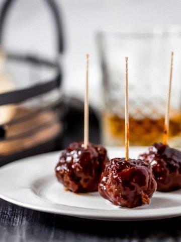 bbq bourbon venison meatballs on a white plate