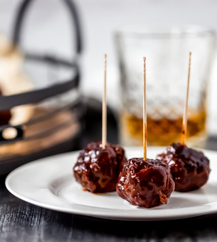 bbq bourbon venison meatballs on a white plate