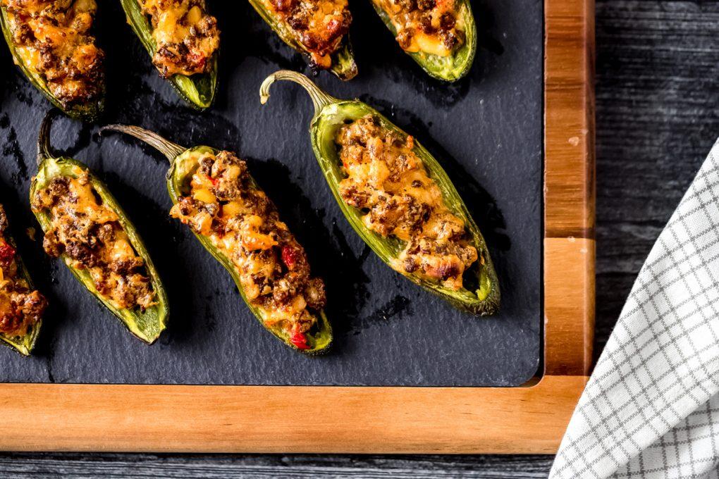 venison stuffed jalapeño peppers on a slate cutting board