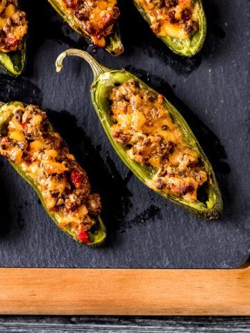 stuffed jalapeño peppers on a cutting board