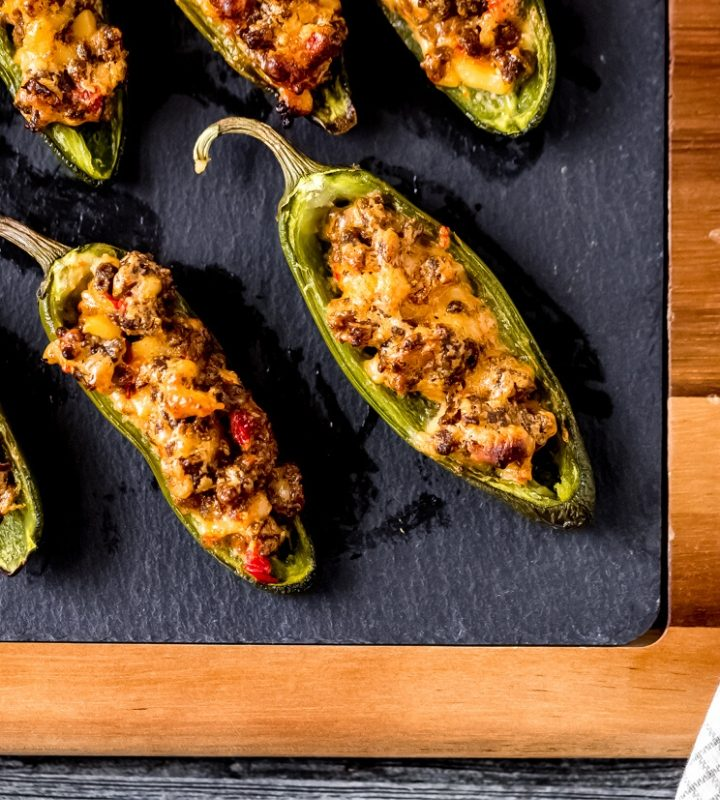stuffed jalapeño peppers on a cutting board