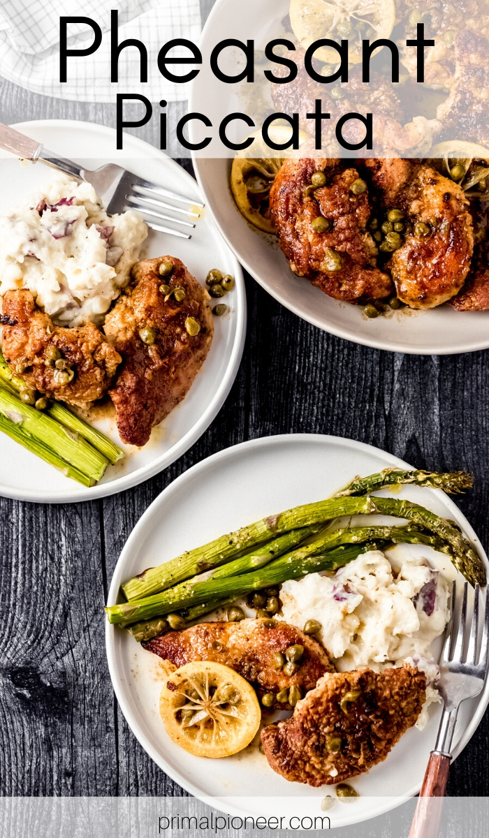 two white dishes of pheasant piccata served with mashed potatoes and asparagus