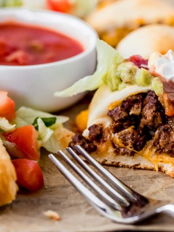 a venison taco ring with a serving cut out