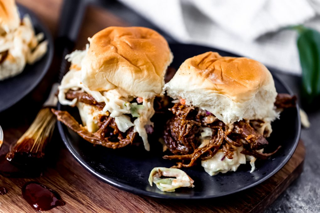 two elk BBQ brisket sliders with spicy slaw on a plate