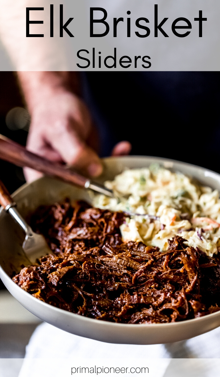 a man holding a serving bowl of elk BBQ brisket and spicy slaw