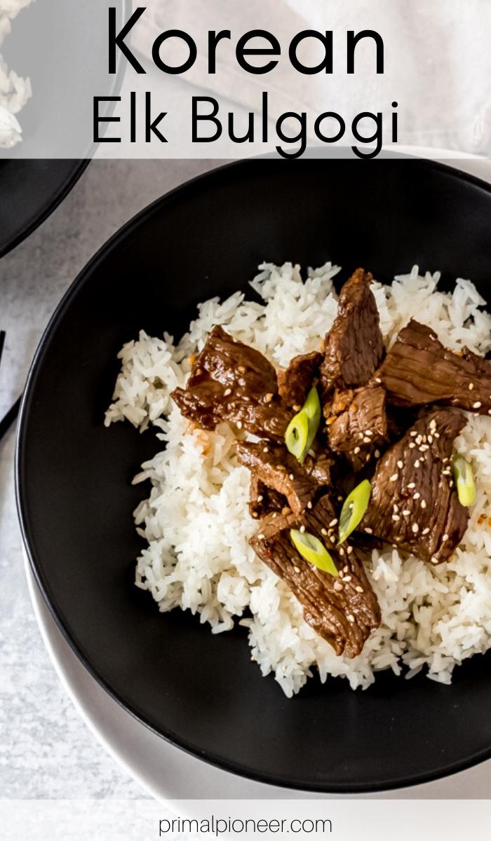 a black bowl of Korean elk bulgogi over white rice