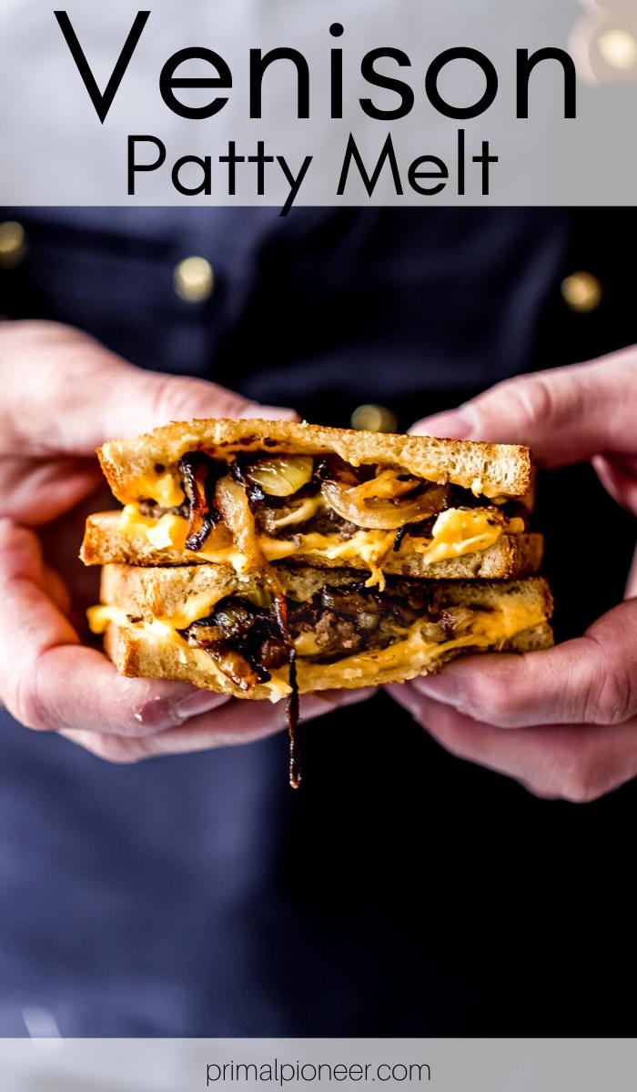 a man holding a venison patty melt sandwich