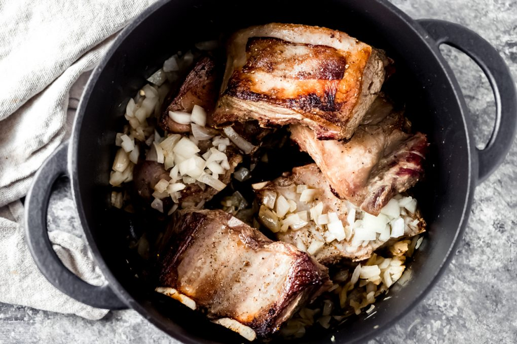 elk short ribs in a dutch oven for braising