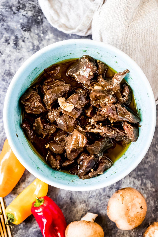 a bowl of venison tenderloin tips marinating