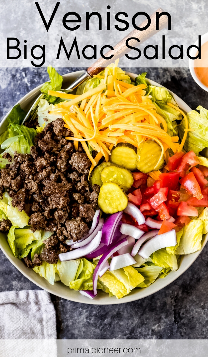 a ground venison Big Mac salad in a bowl with a fork