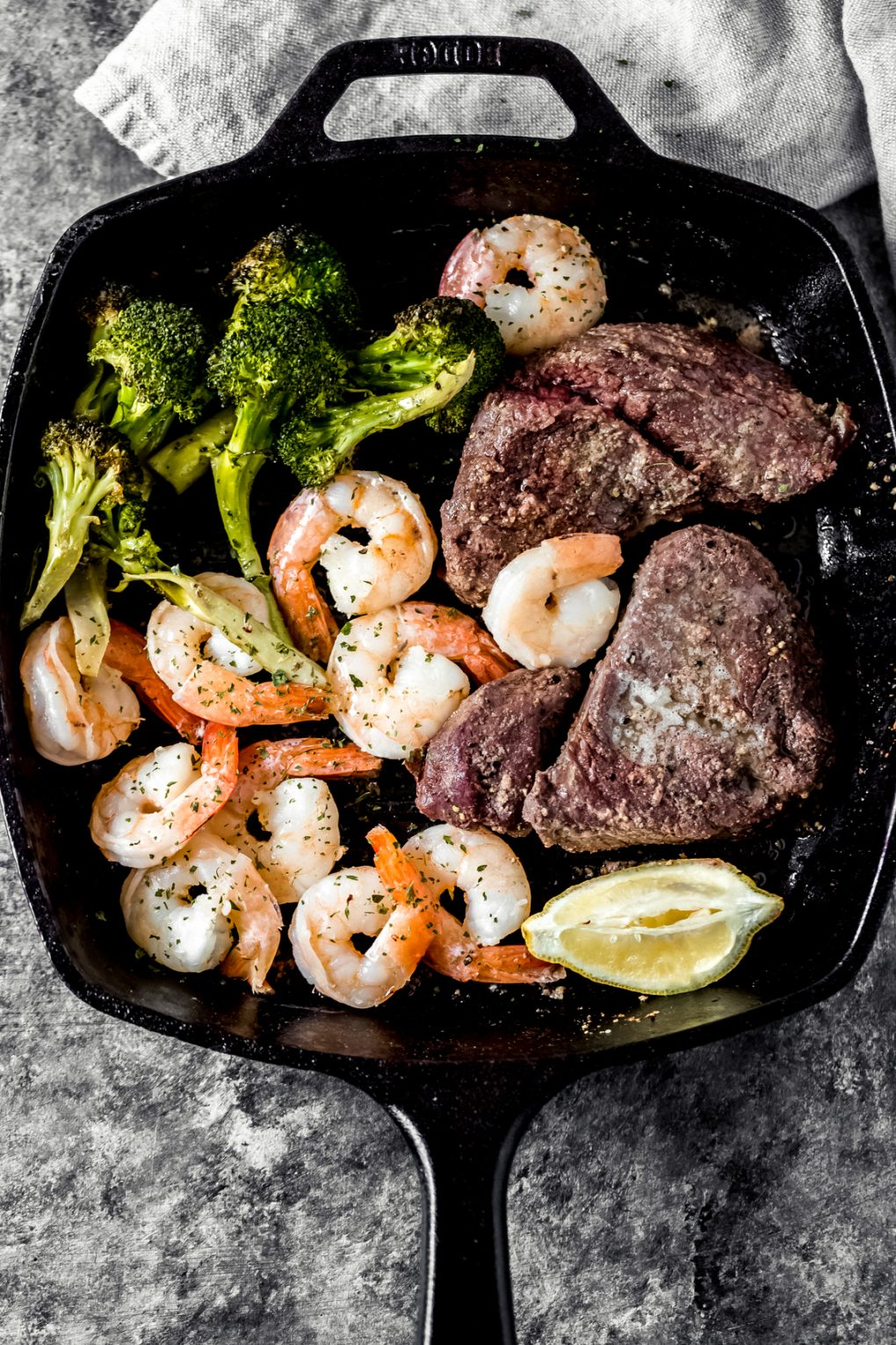 Smoked elk steak and shrimp in a cast iron skillet