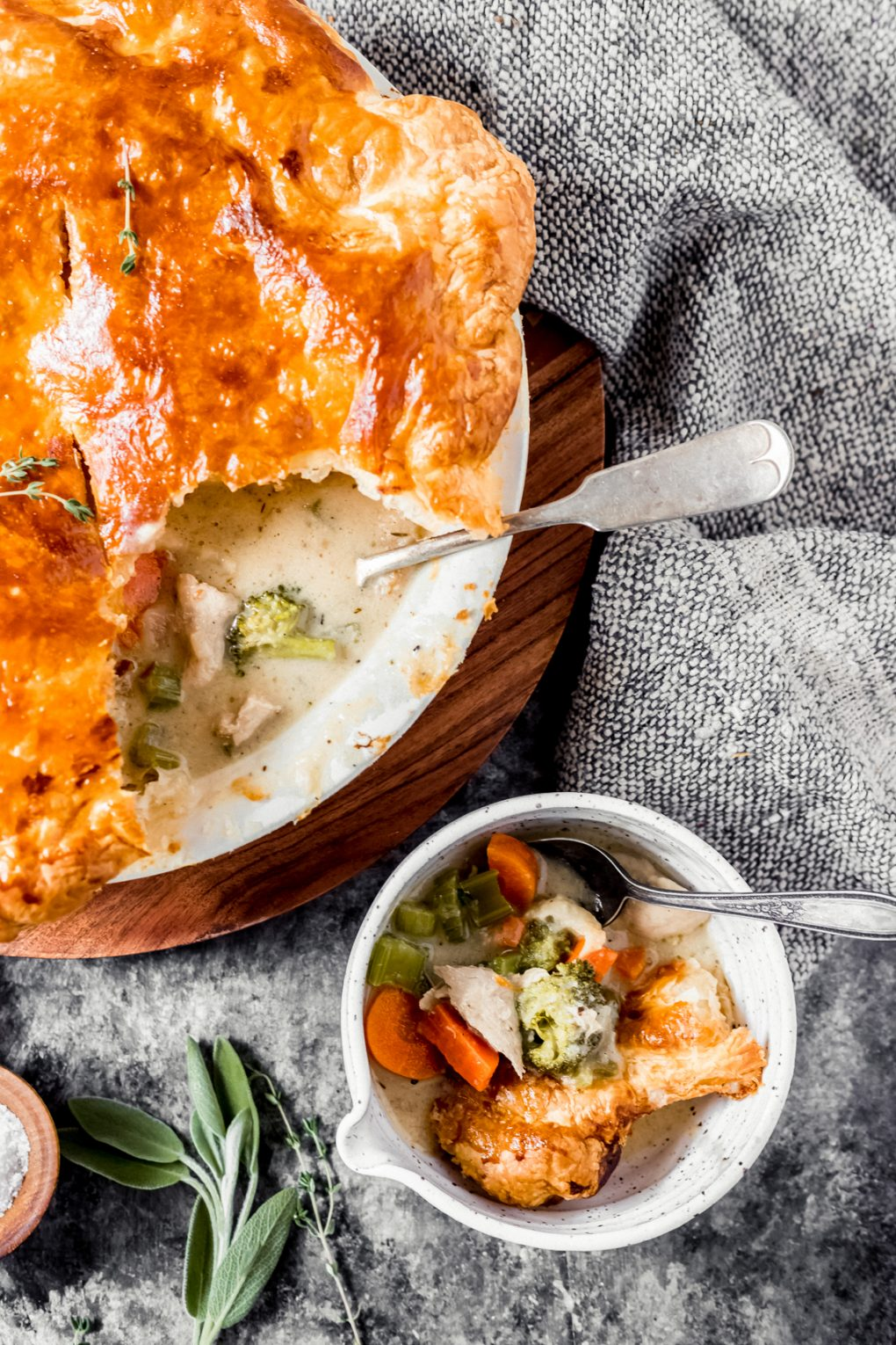 a pheasant pot pie with one serving scooped out and served in a small bowl