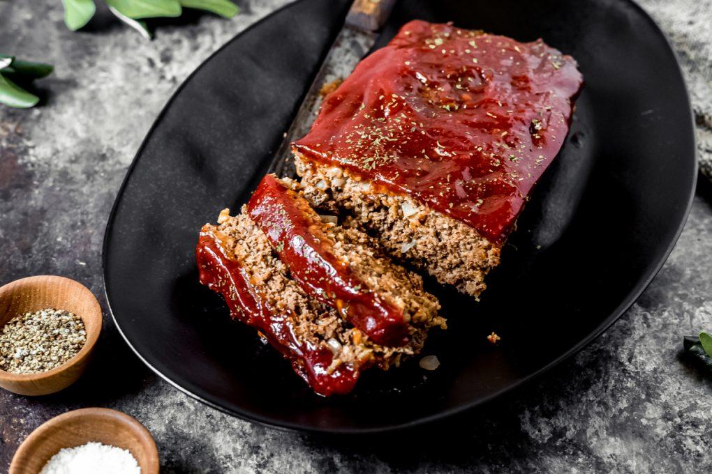 a ground venison meatloaf on a black platter