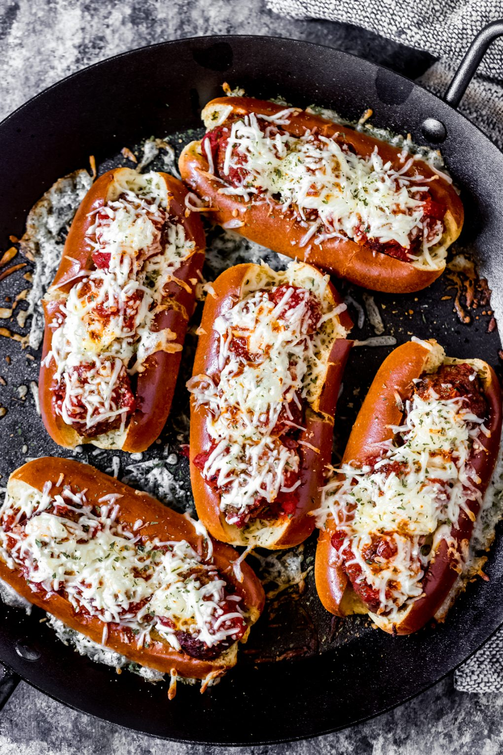a cast iron dish of venison meatball subs