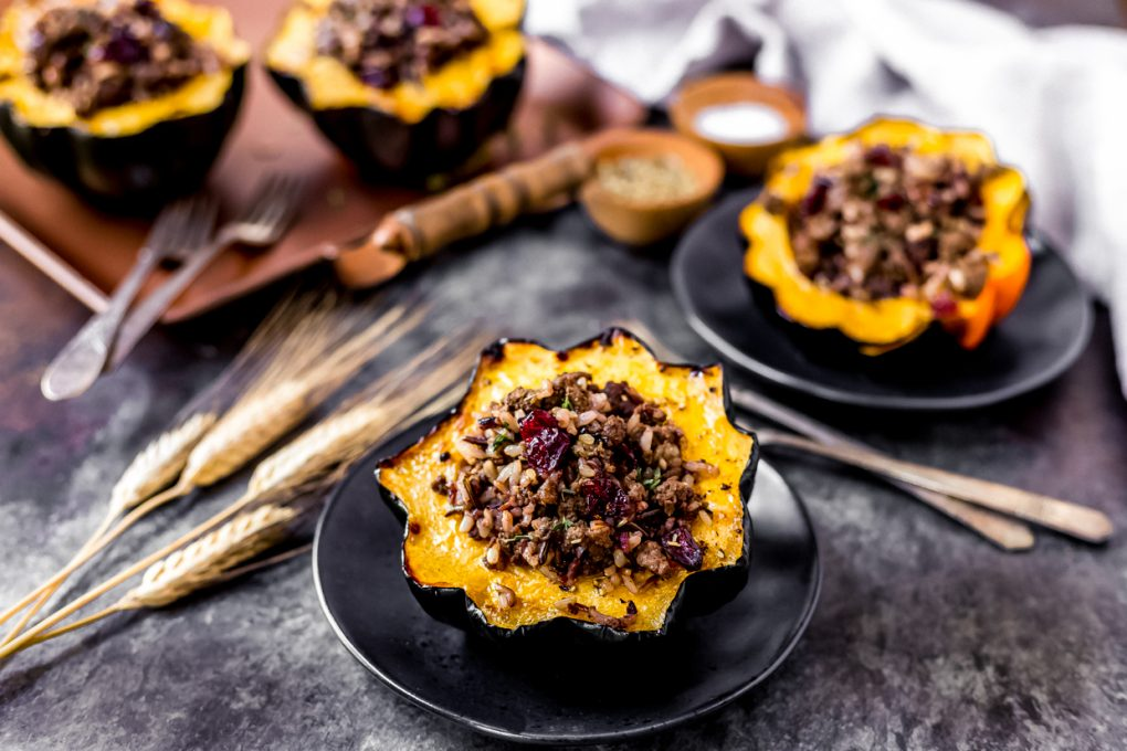 several ground elk stuffed acorn squash on plates