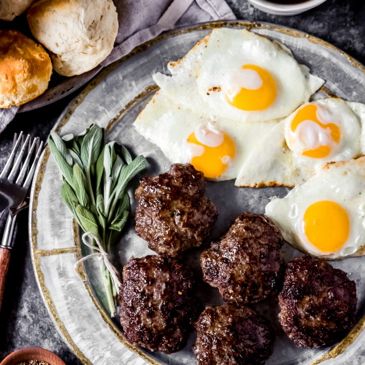 a platter of venison breakfast sausage and eggs