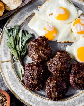 a platter of venison sausage patties and eggs