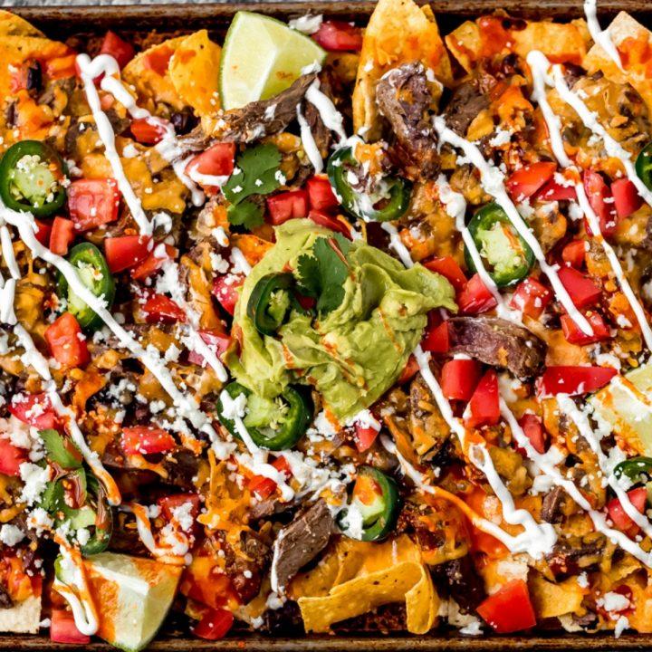 a sheet pan of venison steak nachos