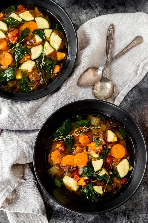 two bowls of venison bone broth vegetable soup