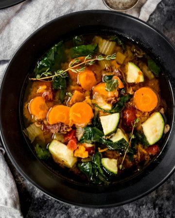 a bowl of venison bone broth vegetable soup