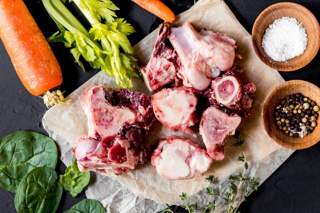 Venison knuckle bones and fresh vegetables for bone broth vegetable soup