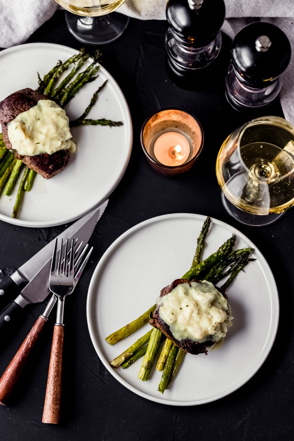 two bison filet mignons on white plates