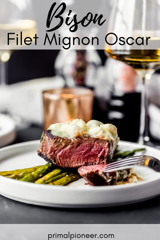 a bison filet mignon Oscar over asparagus