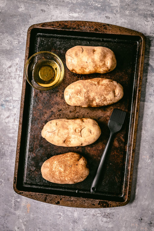 a baking sheet of baked potatoes