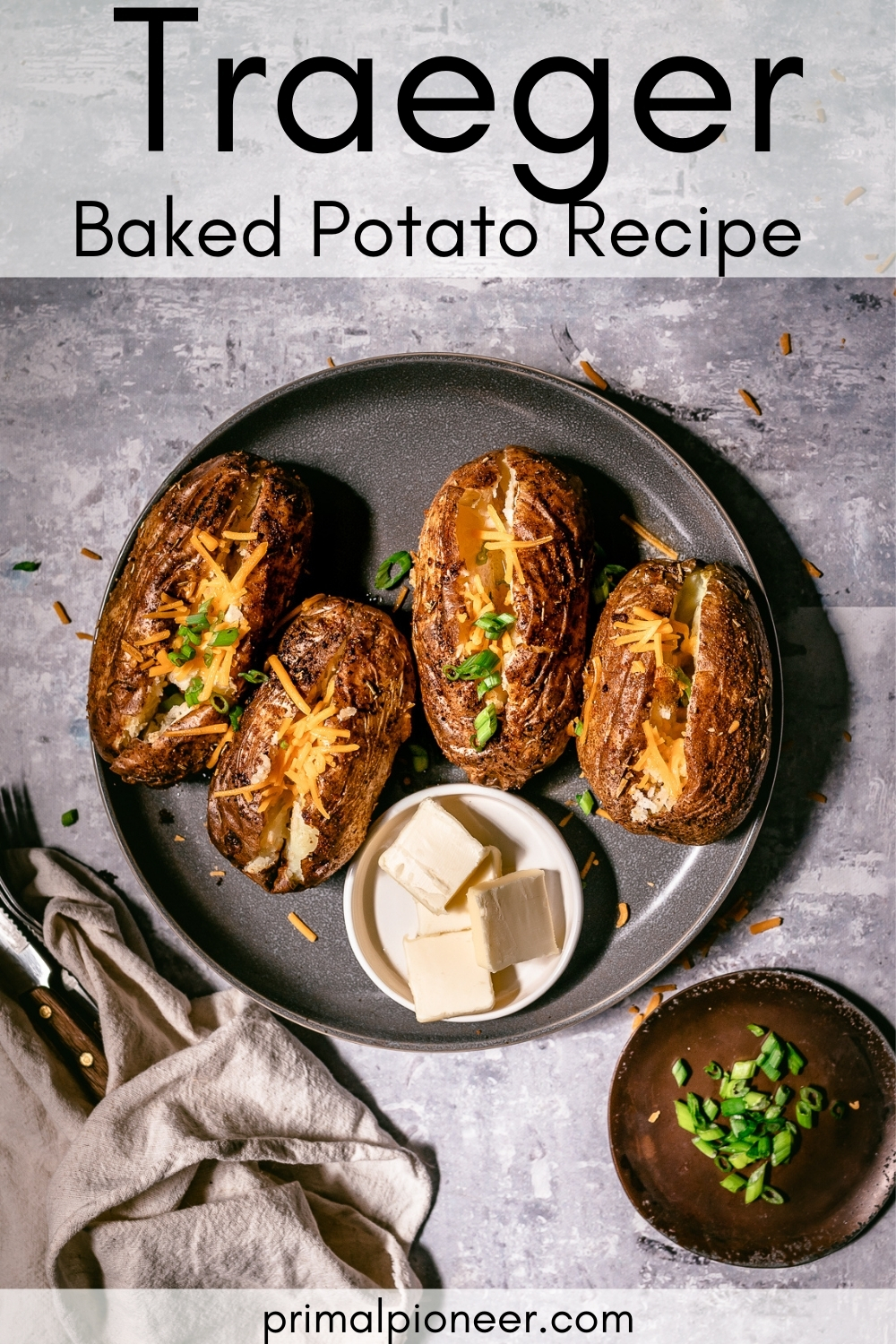 a plate of baked potatoes cooked on the Traeger